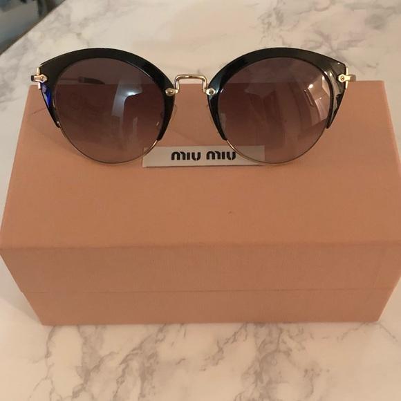 53be52e413ae Miu Miu oversized cat eye sunglasses 52mm. M 5aa1e8a32c705d621a720961